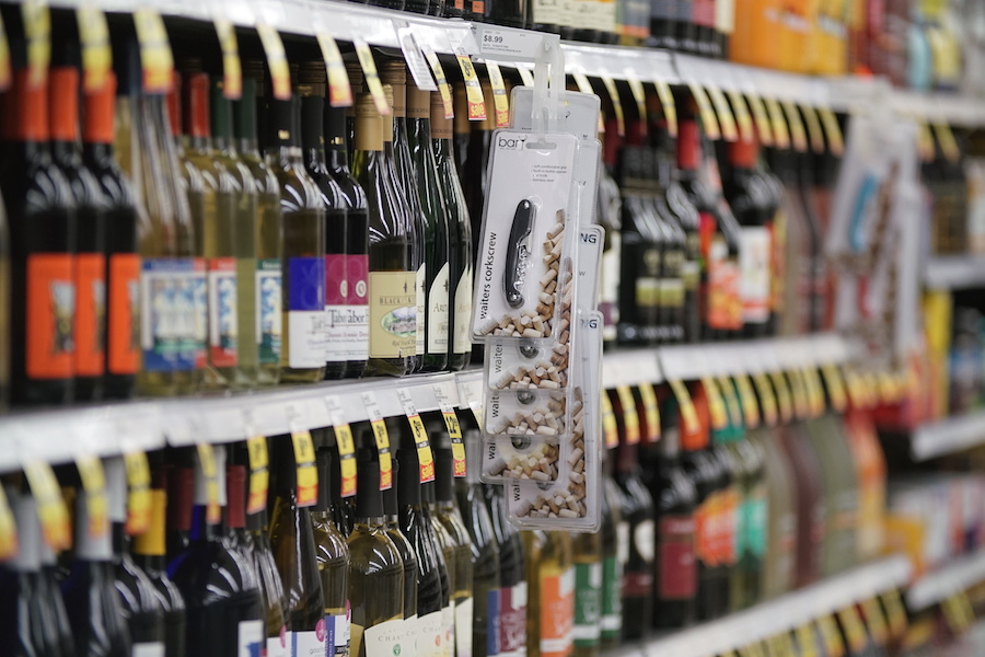 shelves of wine in grocery store